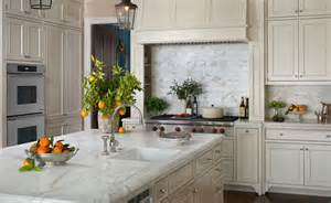 Subway tiles backsplash sink in kitchen island and double ovens