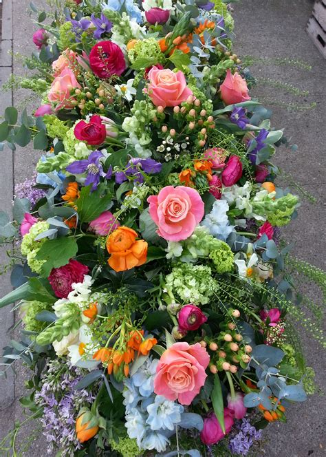 colorful coffin spray floral funeral tribute flower