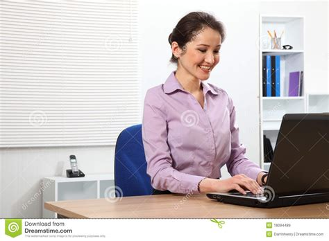 Japanese Office by Business Working On Laptop In Office Stock