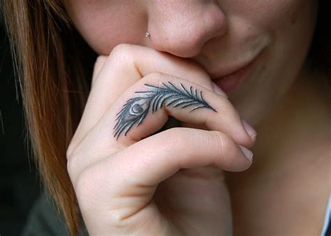 tattoo feather on finger 25 beautiful simple tattoos ideas graphicsbeam