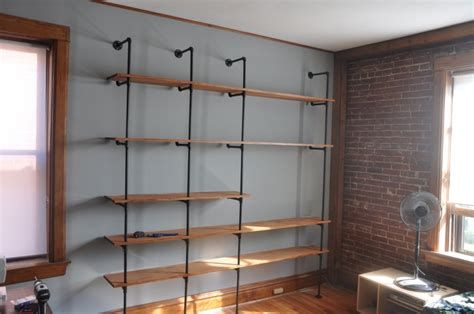picture of diy wood and pipes shelving system