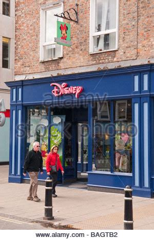 people shopping in the disney store, the village