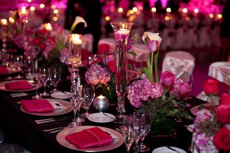 fuschia and purple wedding theme table setting pink and black wedding