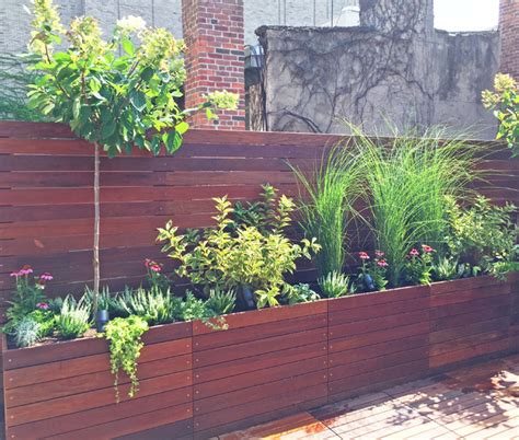 west custom roof deck with planter boxes and fence