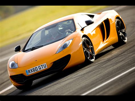 orange mclaren 12c 2012 mclaren mp4 12c orange front angle speed tilt 2