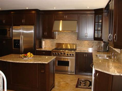 small kitchen design with island beautiful cock love love the dark wood cabinets light granite countertop and