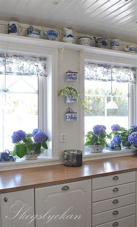 blue and white kitchen with toile valances and wall