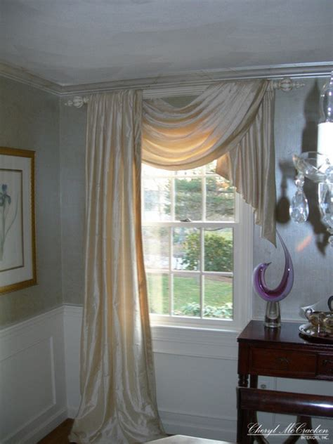 side curtains this swag and jabot on one side and panel on the other add