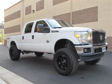ford   xlt crew cab  diesel  white lifted