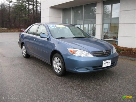 2004 blue metallic toyota camry le 6964097