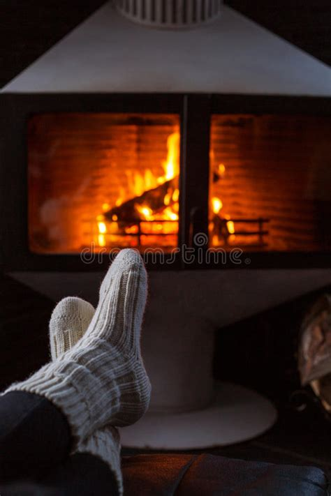 sock fireplace in woolen socks by fireplace sitting at a cosy