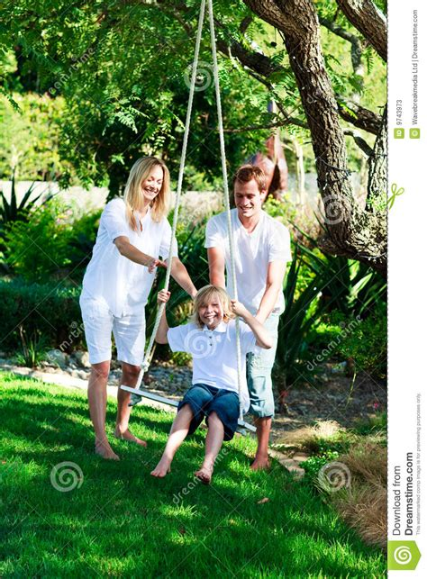 is swinging fun happy family having fun swinging stock photos image 9743973
