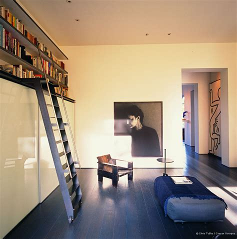 how to live in a small space how to use light and art to open up small spaces in your