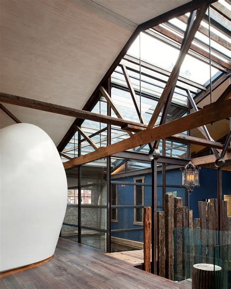 aj c inserts molded white cocoon into renovated warehouse