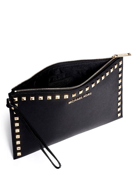 michael kors selma studded leather clutch in black lyst
