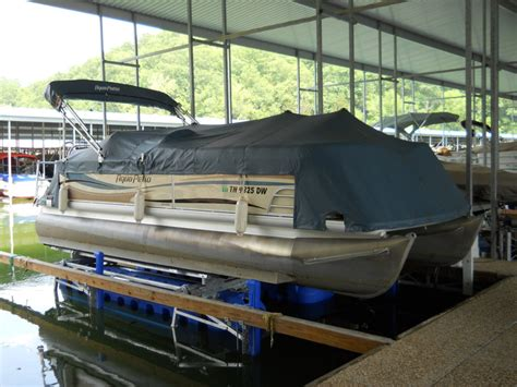 boat lift parts near me aqua patto pontoon boat on a hydrohoist 6600 boat lift