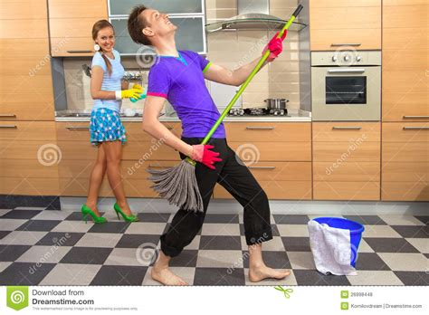 Funny couple on kitchen stock photo. Image of caucasian