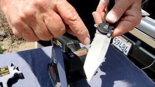 sharpening a gut hook knife with gut hook sharpening using the work