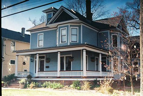 fancy gray house exterior paint idea with white window frames white balustrade and brown roof