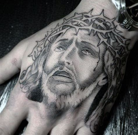 jesus tattoo using hand 20 jesus hand tattoo designs for men christ ink ideas