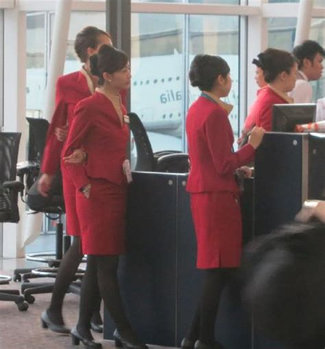 flight attendant wear bangs cathay pacific flight attendants will soon be allowed to