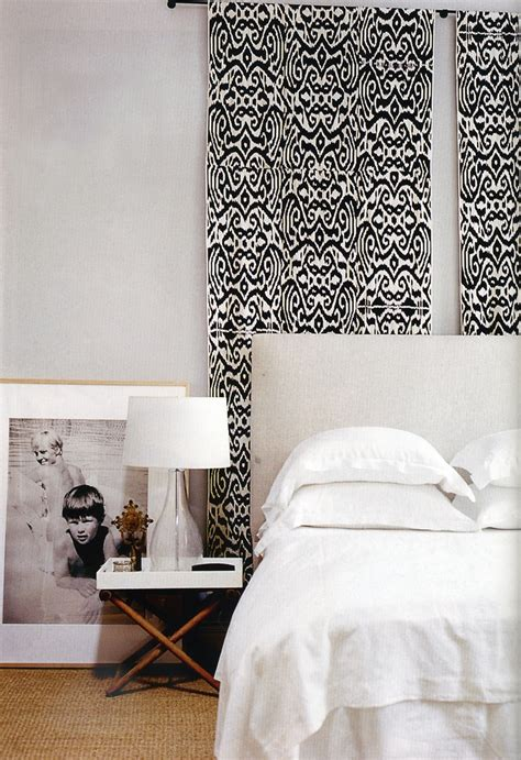 tapestry above bed wall hanging behind bed madeline weinrib black luce ikat