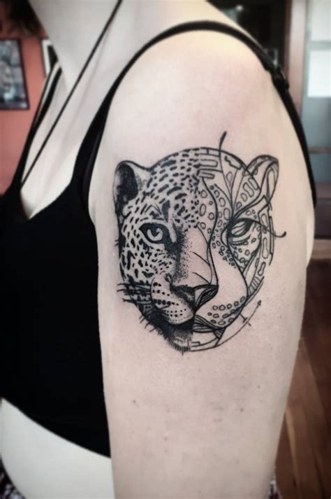 leopard portrait geometric tattoo on half sleeve blurmark