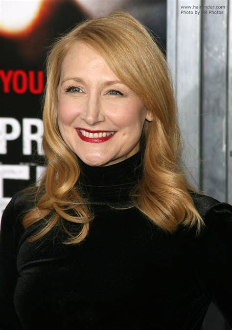 Patricia Clarkson's long hairstyle and reddish blonde hair