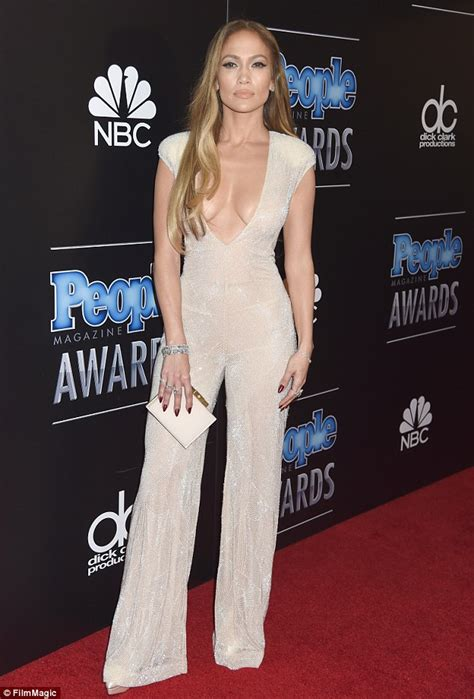 kim kardashian net jumpsuit daily mail jennifer lopez bares her cleavage in plunging jumpsuit at