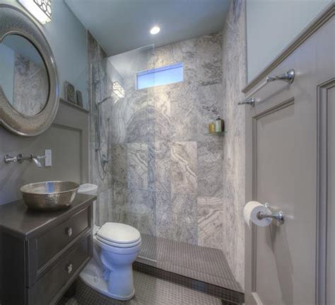 Tile Ideas For Small Bathroom small bathroom with stone tile in shower 516516879 getty robert