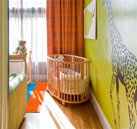 colorful baby nursery ideas with crib and orange