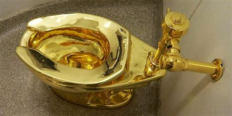 golden toilet gold toilet on display at guggenheim museum in new york