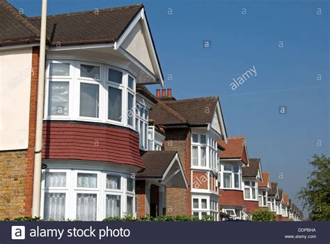 buying a 1930s house row of 1930s houses in ealing west london england with bay windows stock photo