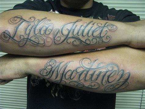 last name tattoos on arm names on arms of and last name on sleeves