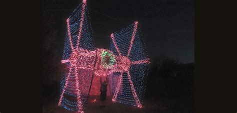 shoot down santa claus with this christmas light tie fighter