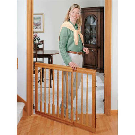 evenflo home decor stair gate evenflo home decor wood swing gate natural oak walmart com