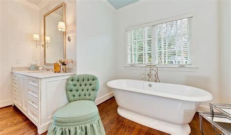 bathtub  front  window transitional bathroom