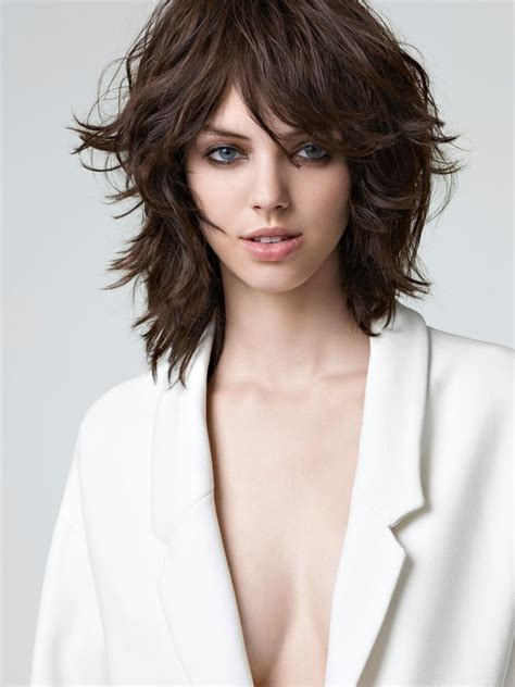 medium length haircuts with lots of layers medium length hair cut with layers texture and bangs