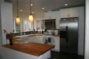 small modern kitchen decoration with black brick backsplah