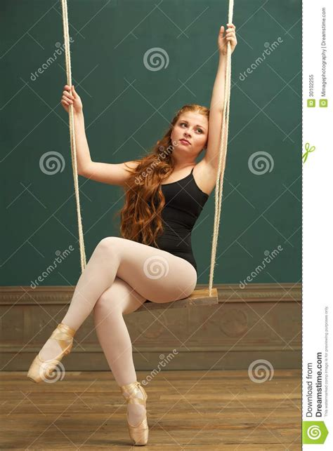 sitting on a swing beautiful ballerina sitting on swing royalty free stock