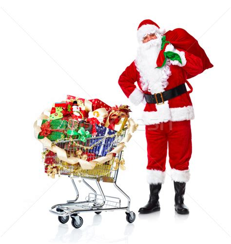 santa claus with gifts and shopping trolley stock photo