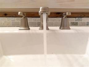 replace kitchen sink faucet how to replace a bathroom faucet how tos diy