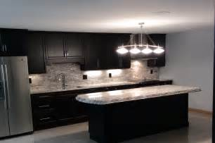 African rainbow granite with espresso cabinets in chesterfield