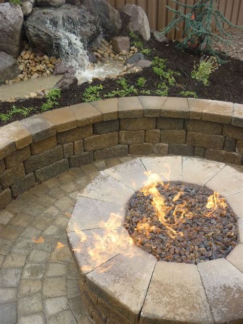 paver pit and water feature in the backyard in utah