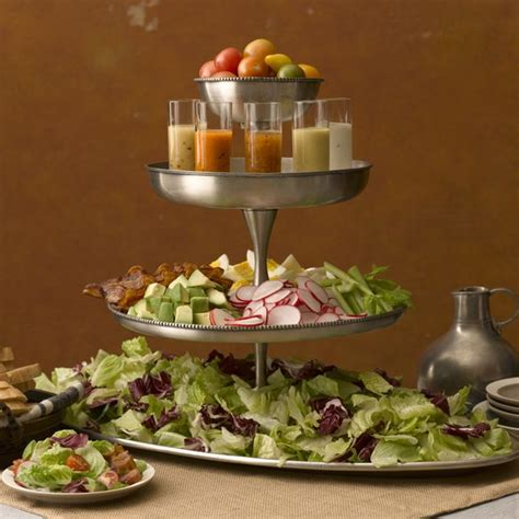 tiered salad bar like the serving of dressing in small