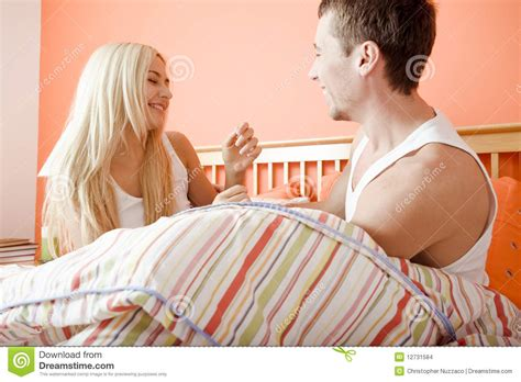 sitting in bed young couple sitting up in bed stock images image 12731584