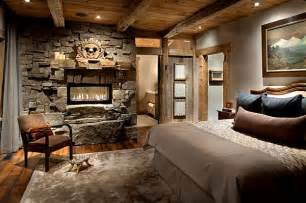 Modern rustic bedroom design with stone wall and fireplace