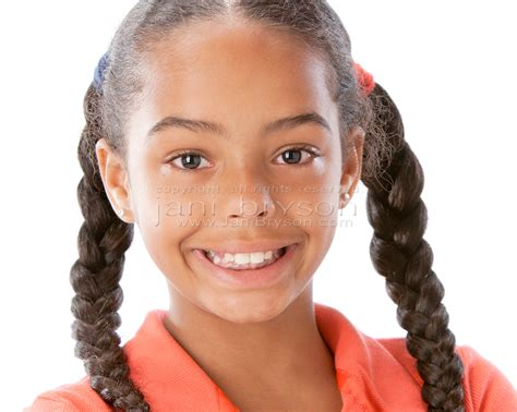 braids on black 5 year olds real people african american smiling little girl closeup