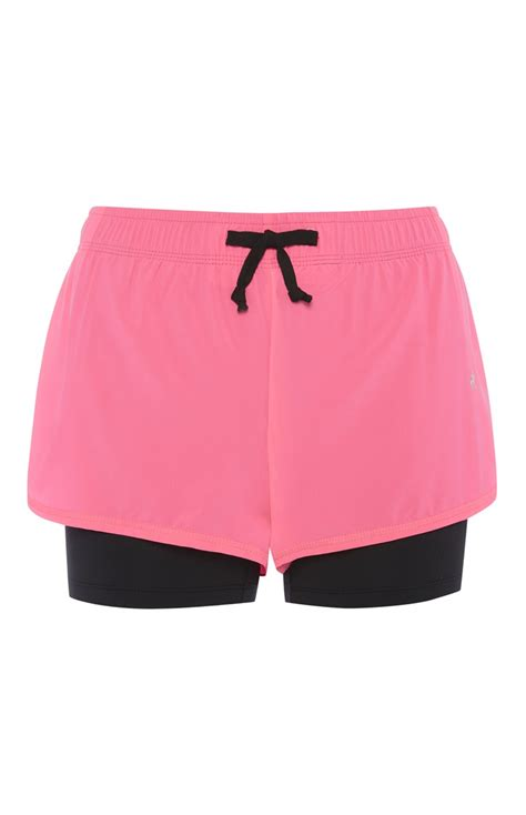 Vsh3241 Set 2in1 Jumper Sporty wear this neon pink 2 in 1 running shorts for looking stylish from primark