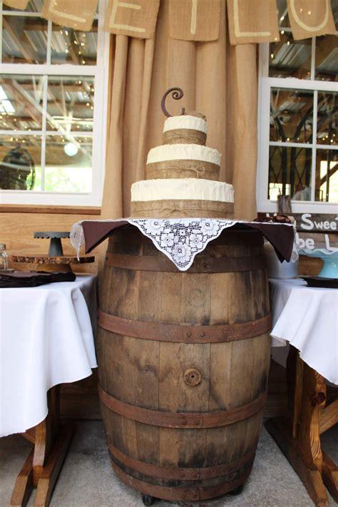 wedding cake  burlap ribbon trim  whiskey barrel